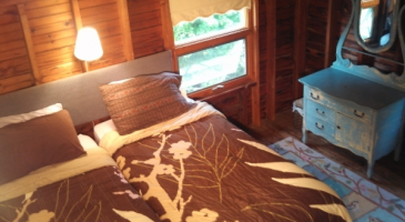 South bedroom with two twins, closet, dresser and trunk, gets warm late afternoon sun