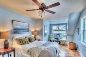 Master bedroom with queen sized bed with sitting area